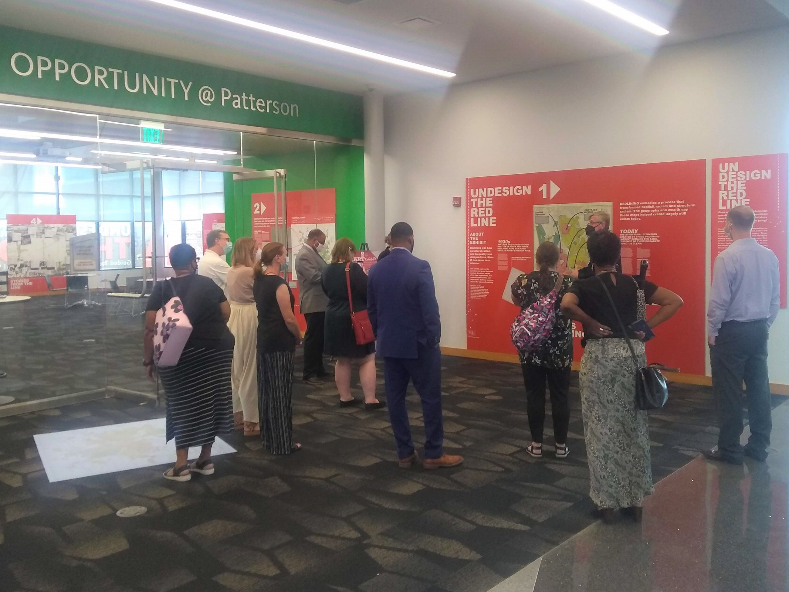 Image of staff viewing exhibit