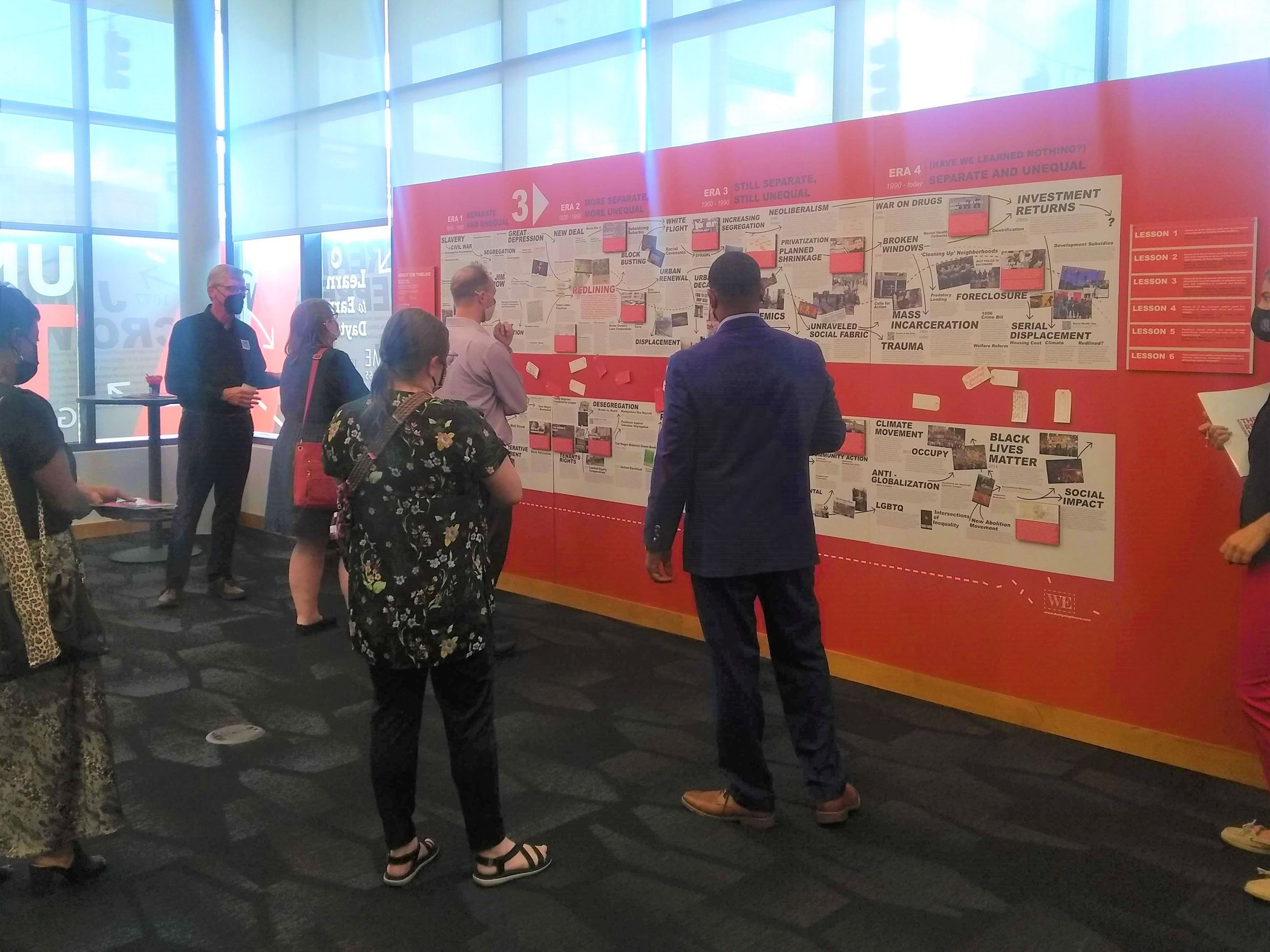 Image of staff viewing timeline from exhibit