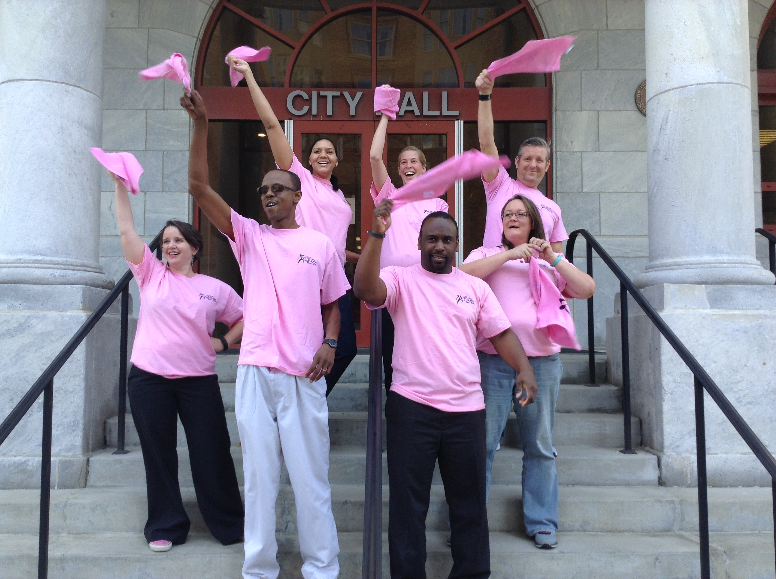 Pink towels waving at City Hall